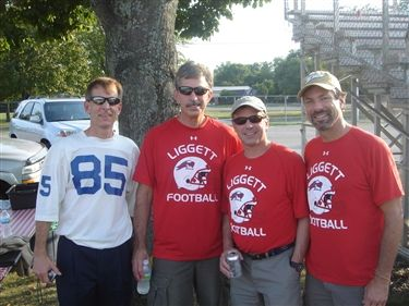 Alumni gather at the Liggett football scrimmage in New Haven, Mich.
